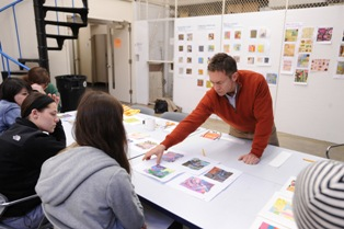 Doug Goldsmith, an assistant professor in Kent State University's School of Visual Communication Design, conducts a review of student work during a class session in the Art Building. Kent State's School of Visual Communication Design was recently featured