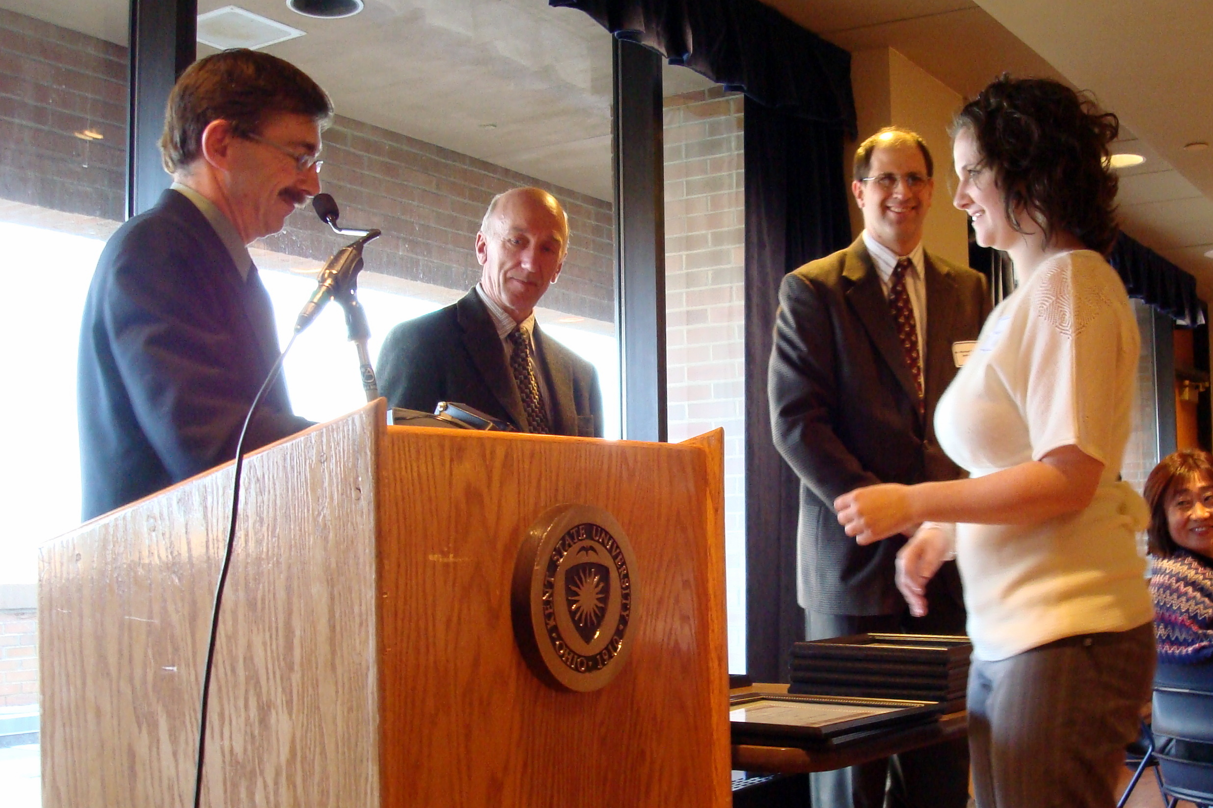 An undergraduate student receives an award during the Honors Day Celebration.
