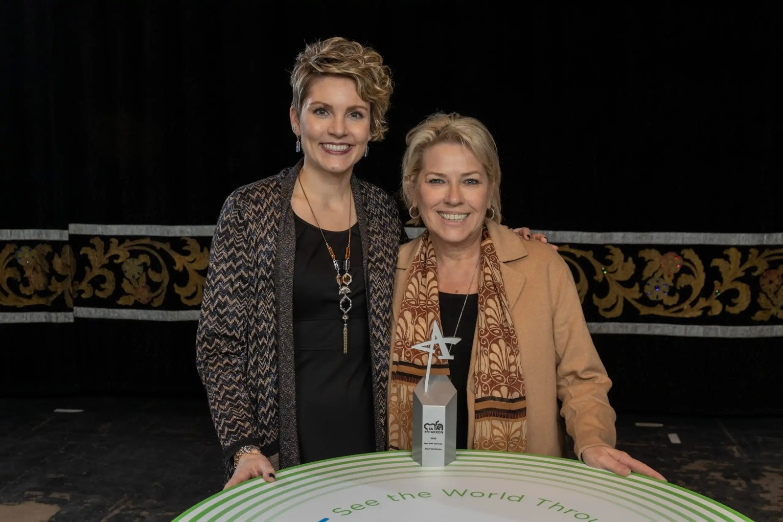 Leigh Greenfelder and Valoree Vargo smile after Kent State's Division of Institutional Advancement took home its first ADDY, a silver award, for the Support Global Education video project. (Photo credit: Smithberger Photography)