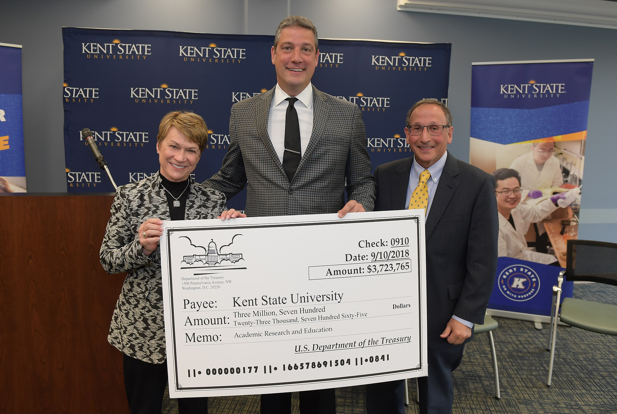 U.S. Rep. Tim Ryan (center) presents a giant check to Kent State University President Beverly Warren (left) and Kent State Vice President for Research and Sponsored Programs Paul DiCorleto (right).