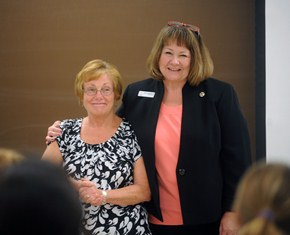 Cathy Snelson (left), associate lecturer at Kent State University's College of Nursing, is recognized as a Nurse Educator With the Nurse's Touch by Susan Yowler from ATI Nursing Education