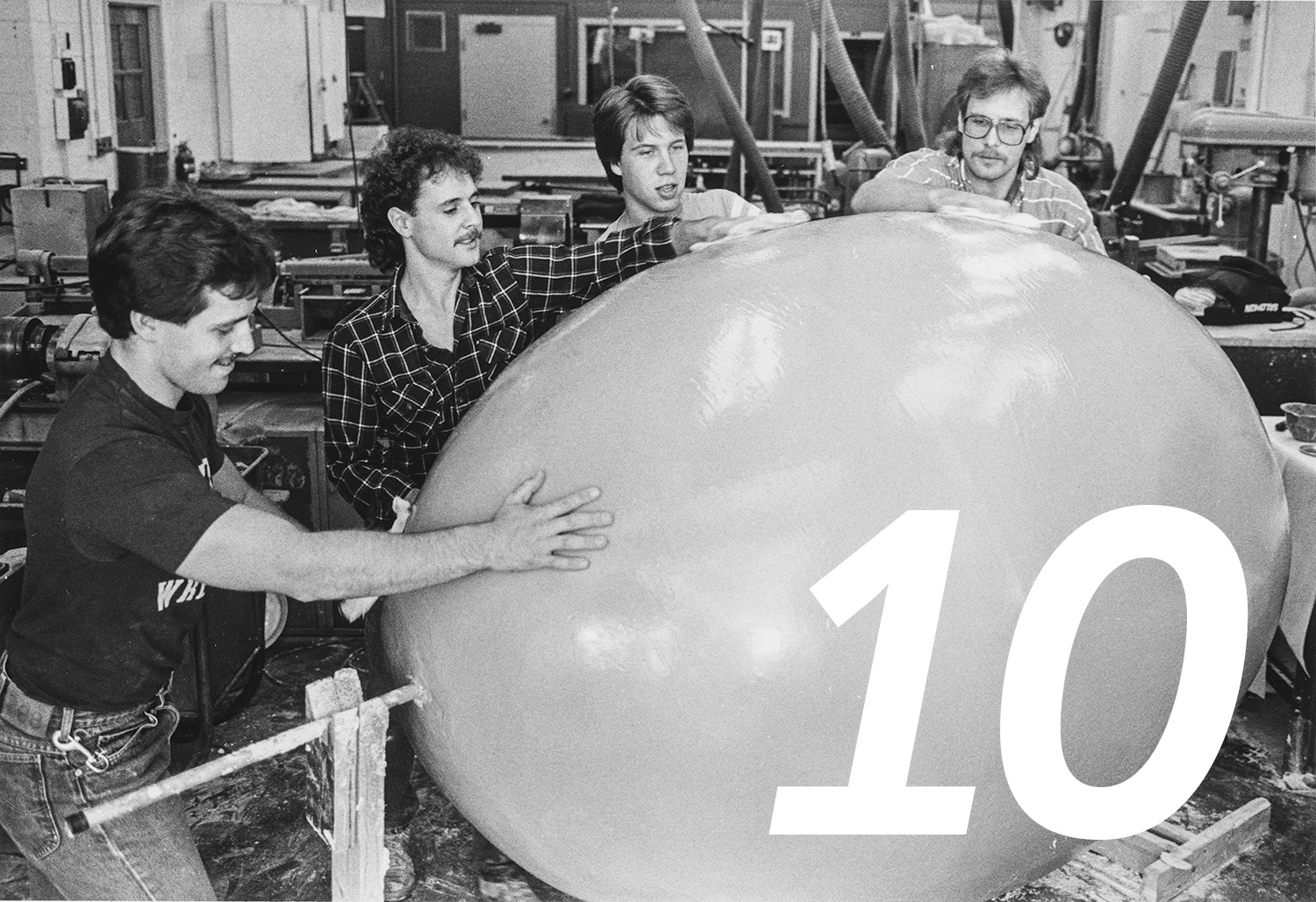 Kent Technology Education Club members polish a fiberglass and resin egg in 1985