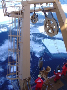 Researchers aboard the icebreaker USCGC Healy prepare to deploy a piston core near the location off the Alaskan coast where the core in this study was recovered.