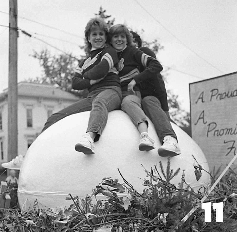 """Flash """"hatches"""" from a giant egg that is displayed during the Homecoming Parade, 1985"""