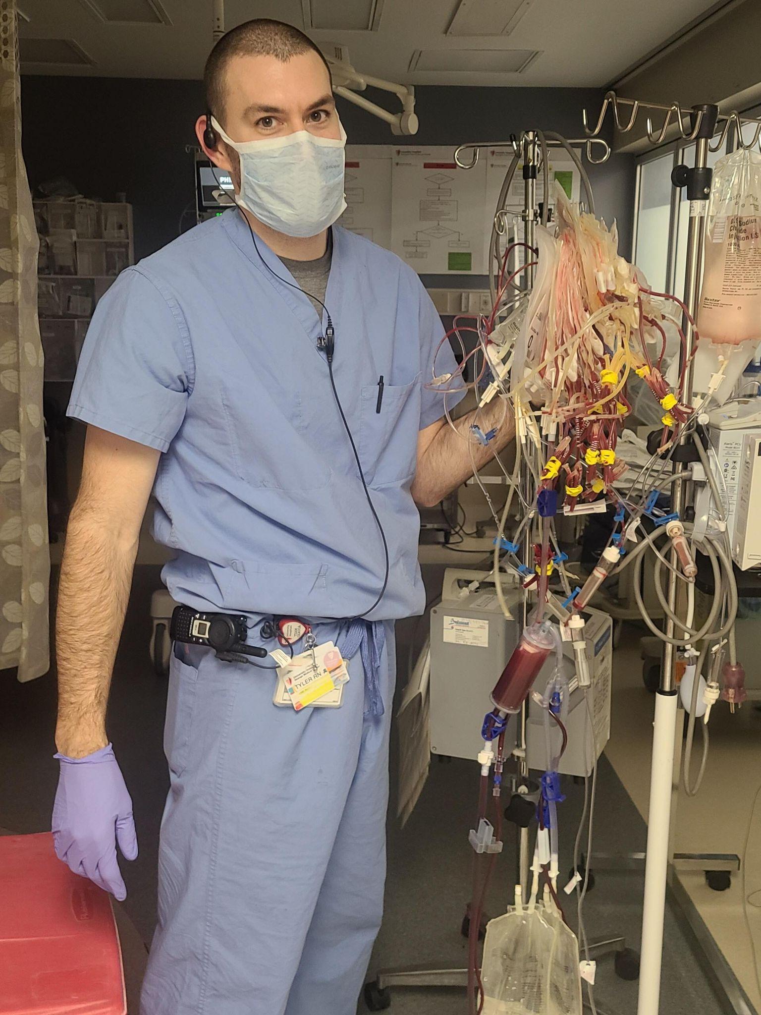Tyler Hostetler working in the ER
