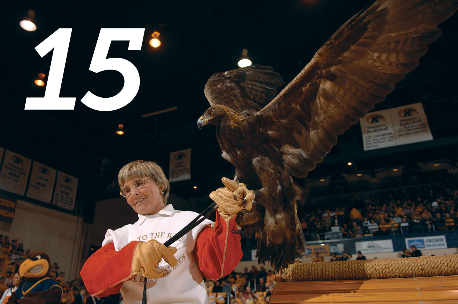 Mona Rutger and rehabilitated eagle at a men's basketball game in 2008