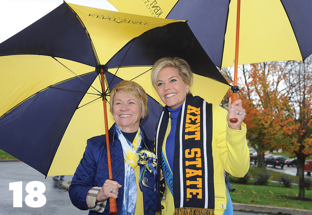 President Beverly Warren celebrates her first Kent State Homecomingand poses with Grand Marshal Tracy McCool, BS '94