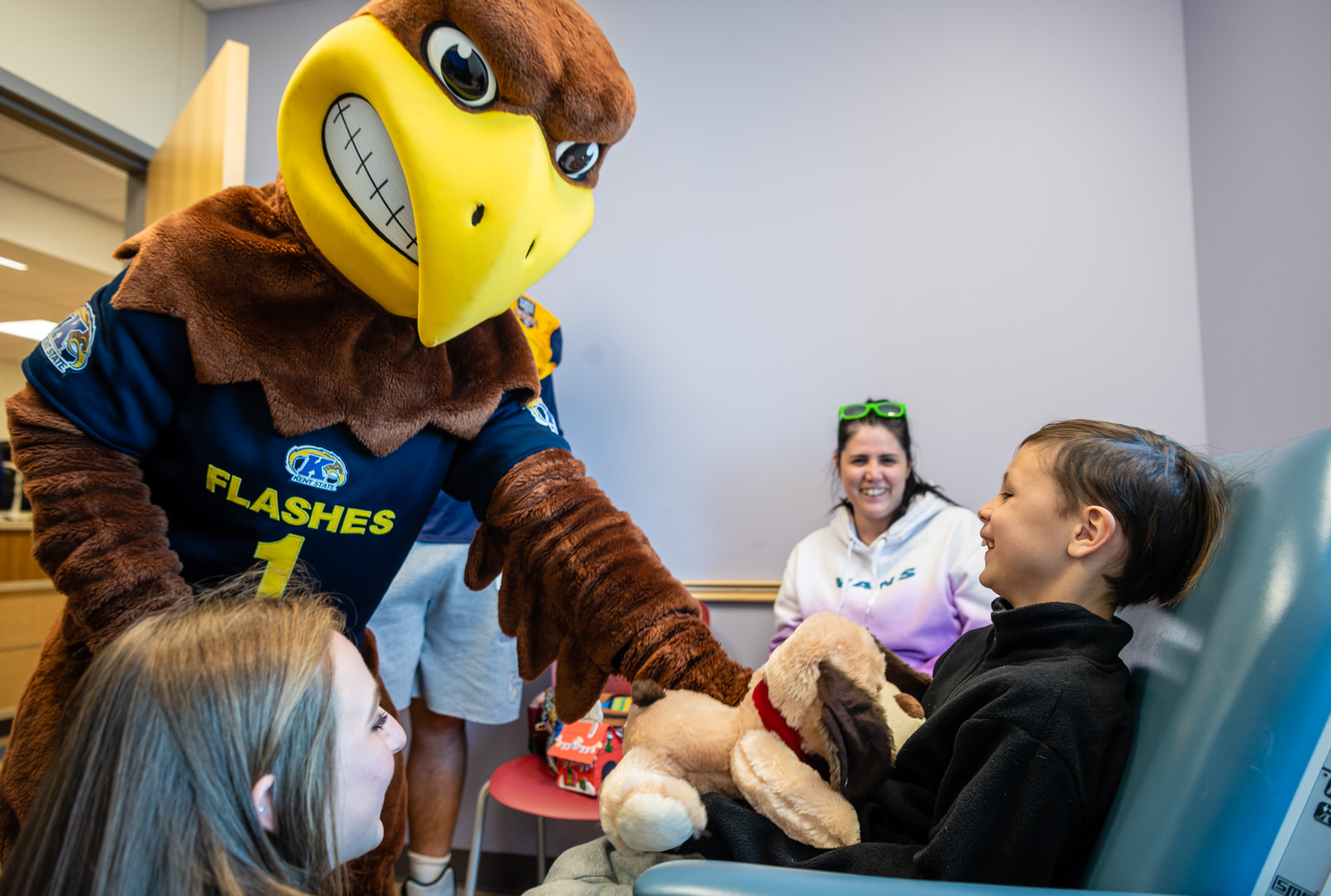 Flash joined football players, cheer and dance members and the marching band in visiting kids at Children's Medical Center Plano ahead of the 2019 Frisco Bowl