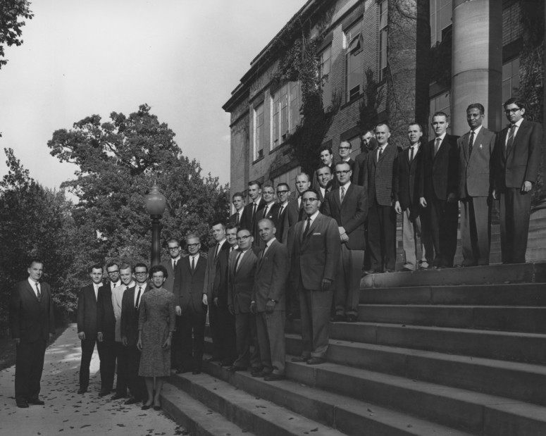 In 1961, the first class of Ph.D. candidates posed on the steps of Merrill Hall. The original doctoral programs were in the chemistry, English, history, biology, and education.