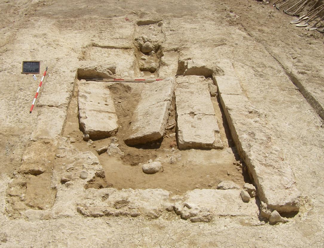 Excavated burial tomb, possibly Etruscan, discovered in summer 2019 by Kent State researcher Dr. Sarah Harvey and her Italian colleagues. Shows 3 stone slabs and the entry way (at top).