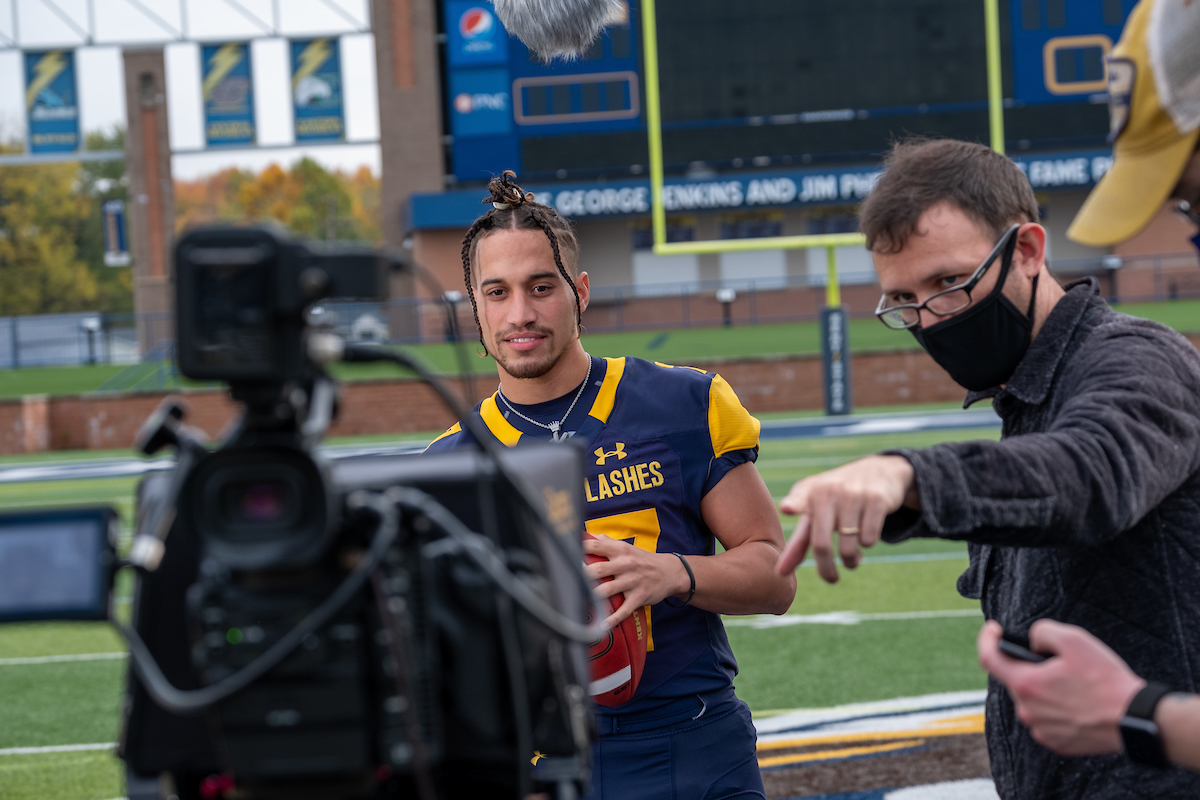 Kent State wide receiver Isaac Vance takes direction from a director while filming his shots for the thank you commercial airing during football games this season.