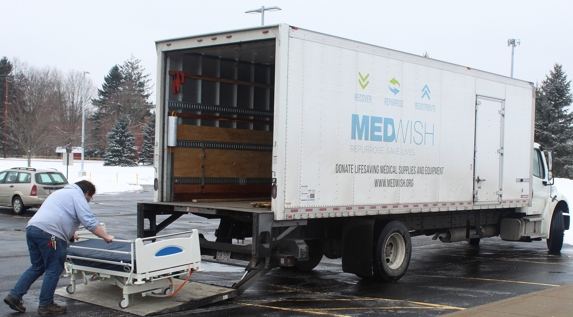 MedWish truck picking up Kent State Geauga bed donations