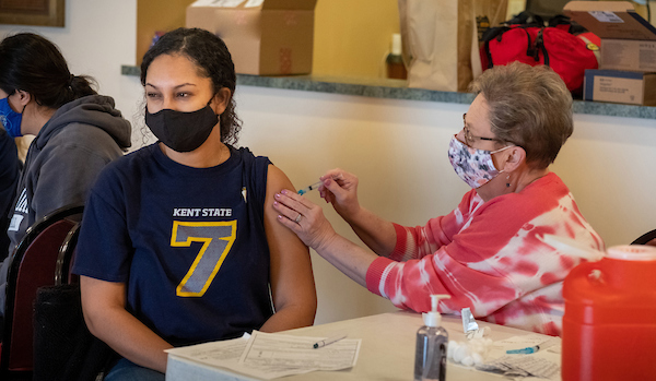 Stella-Ruby Marcher, a Kent State students, receives a COVID-19 vaccine.