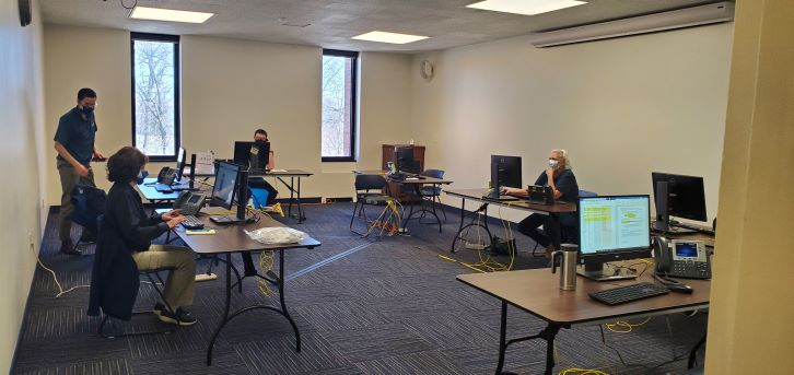 Kent State employees volunteer at a call center to help register Portage County residents for a COVID-19 vaccine.