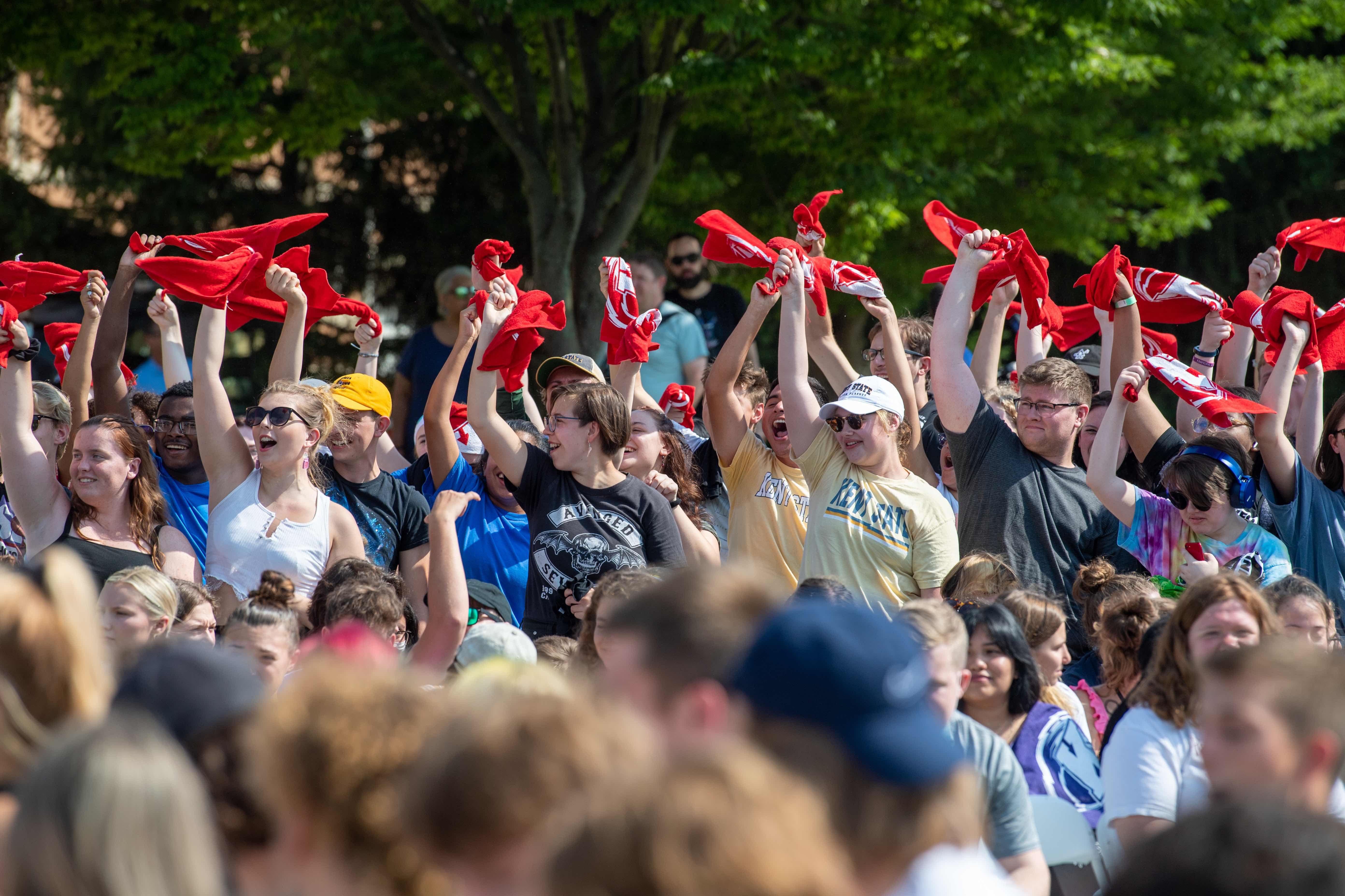 Students waving shirts at Convocation