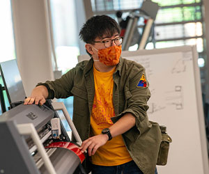 Student in DI Hub, working on a project
