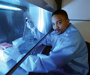 Photo of student in a lab