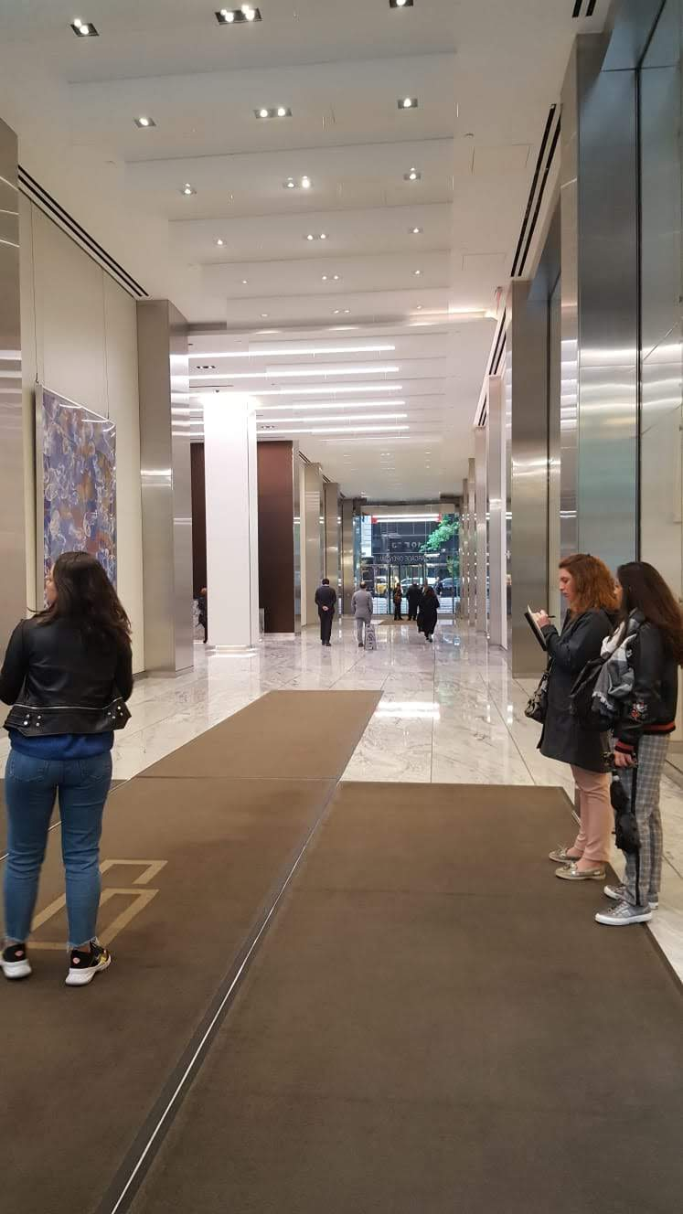 students in a lobby in NYC