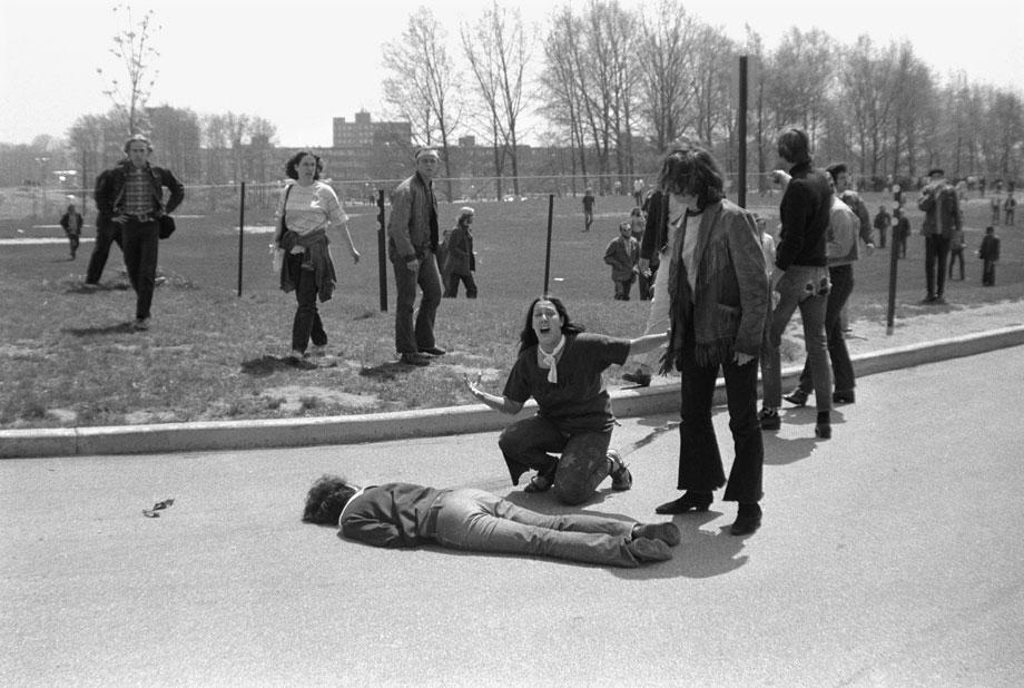Photo: Mary Ann Vecchio kneeling over the body of Jeffrey Miller