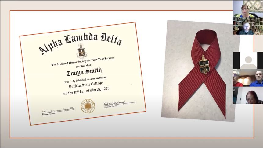 Screenshot of the ALD ceremony, showing the certificate and insignia pin that will be mailed to inductees.