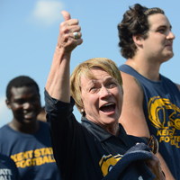 "Dr. Beverly Warren, president of Kent State University, gives the thumbs up after being dowsed with a bucket of ice water on the field at Dix Stadium as a part of the ""Ice Bucket Challenge."""