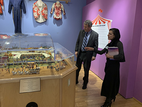 Alex Coon showing Senator Sherrod Brown an exhibition at the Massillon Museum.