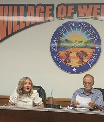 Maia Amato takes her seat at the Wellsville Village Council table.