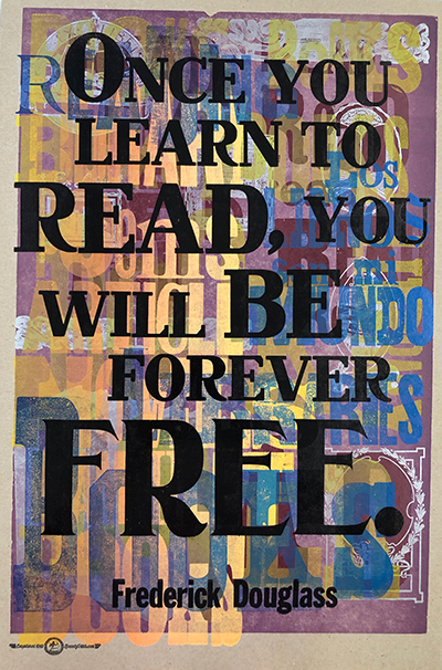 A printed poster that reads Once you learn to read, you will be forever free. -Frederick Douglass - Artwork by Amos Kennedy