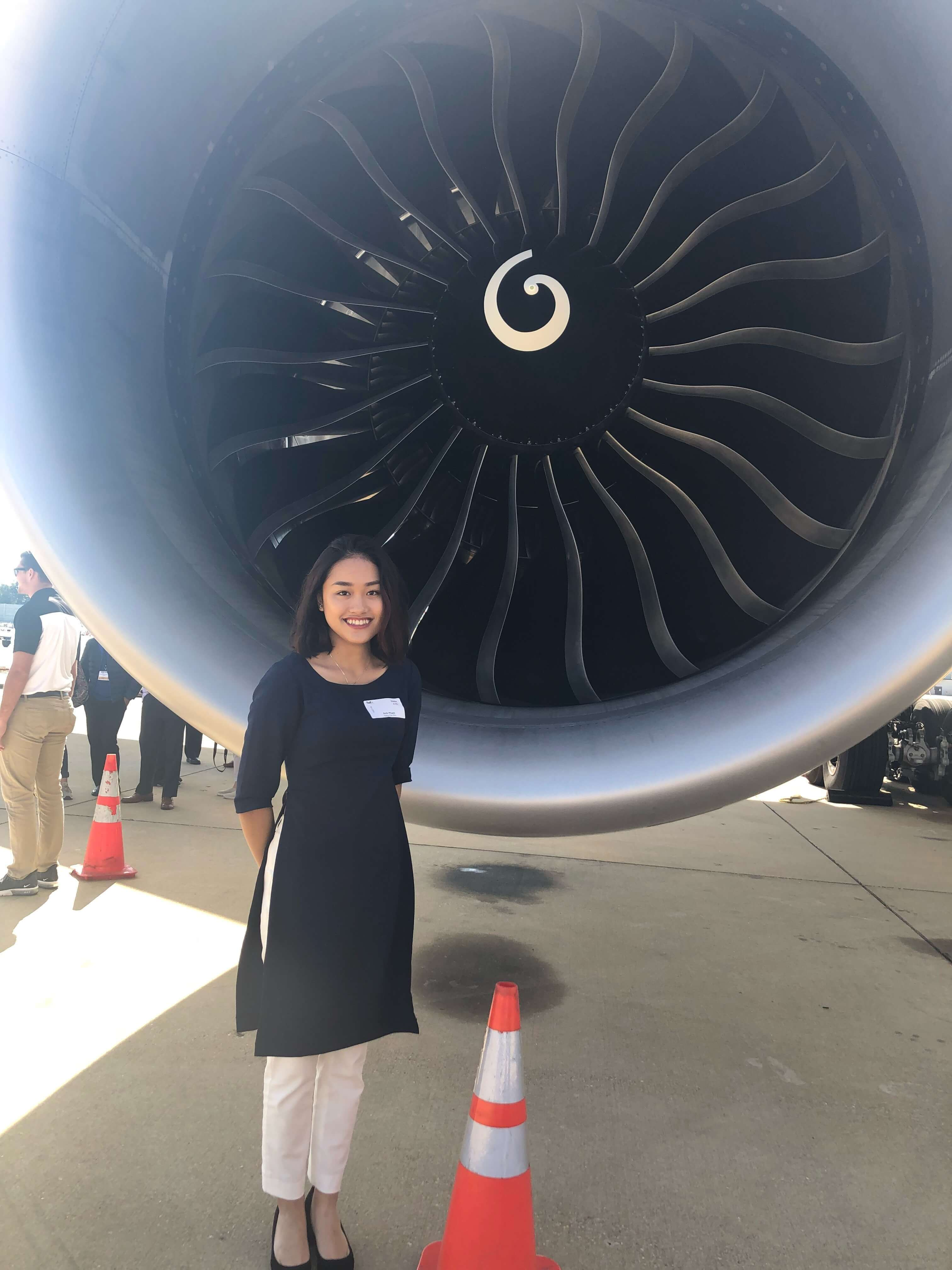 Student in front of jet engine