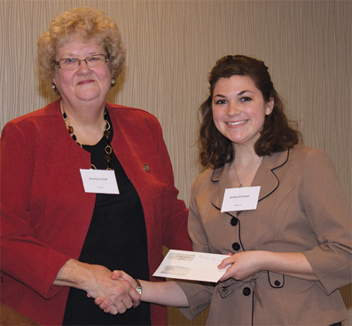 Kent State University nursing student Ashlee Schirripa of Mentor, Ohio, accepts a scholarship from Davina Gosnell, chairperson of the Ohio Nurses Foundation Board of Directors.