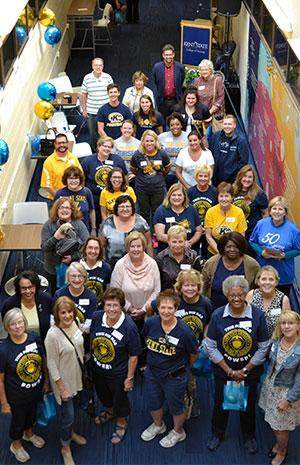 College of Nursing 50th anniversary celebration photo of alumni, students, staff
