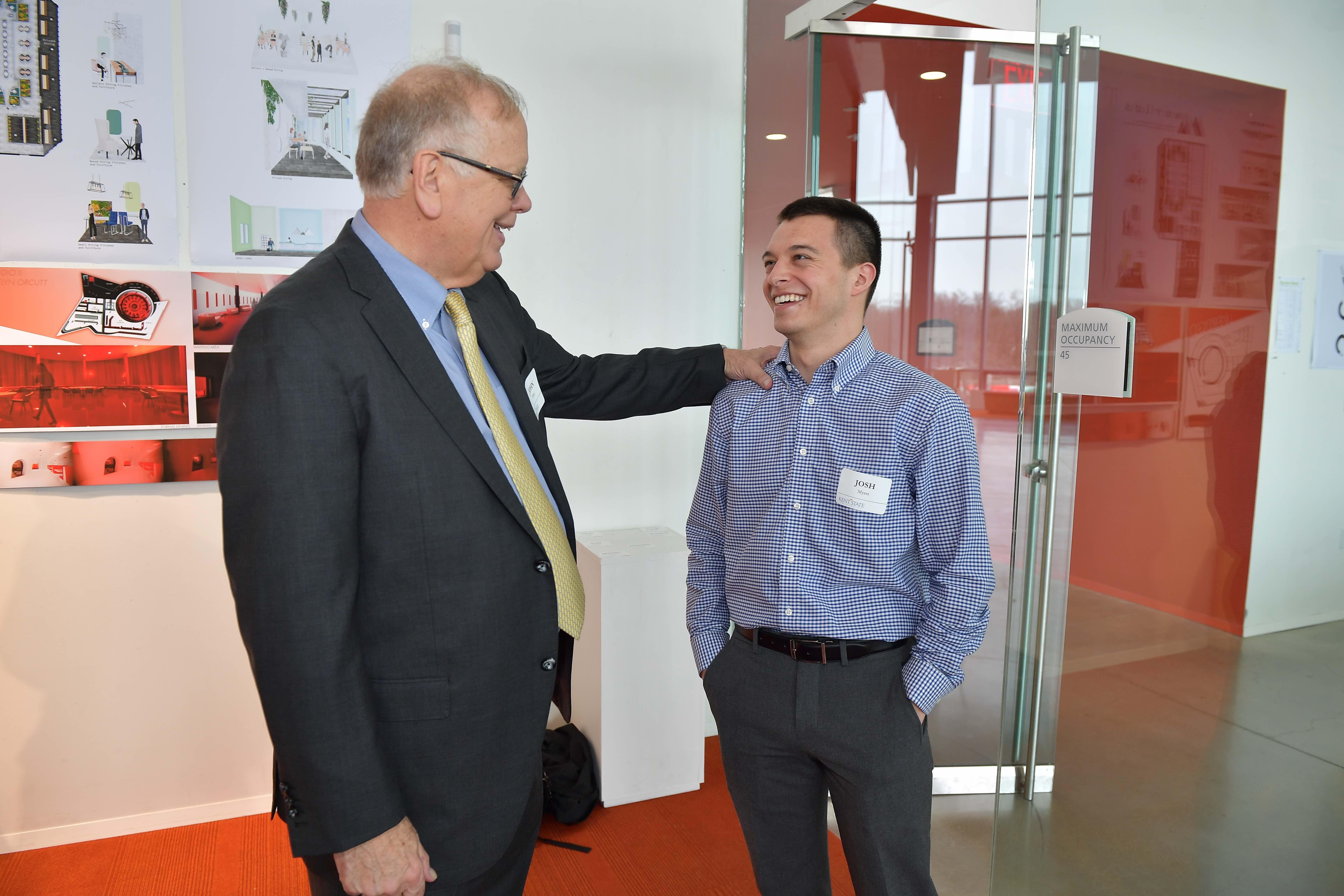 John Elliot talking with a student