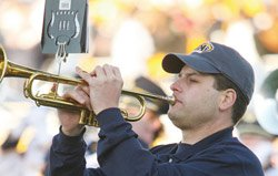 Kent State student playing a trumpet