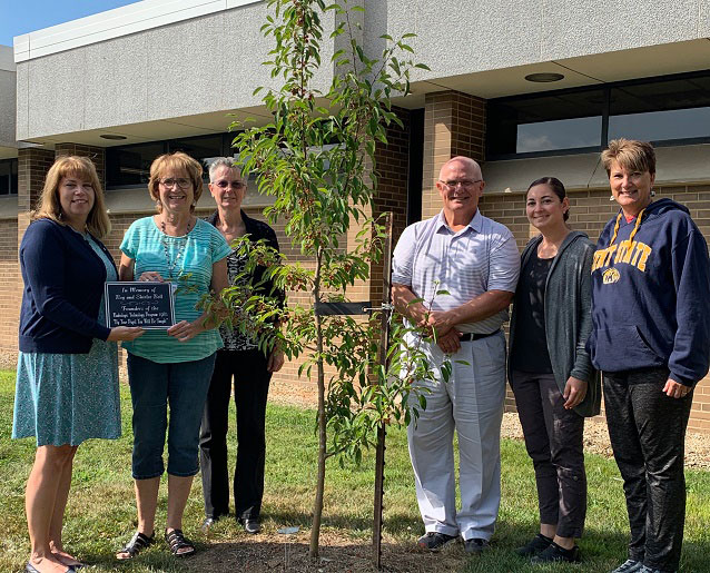 Dedicating a tree on the Kent State Salem Campus in memory of Roy and Shirlee Bell were (from left) Cynthia Peterson, Jan Gibson, Judy Miller, Dr. David Dees, Kelly Dragomir and Margie Iagulli