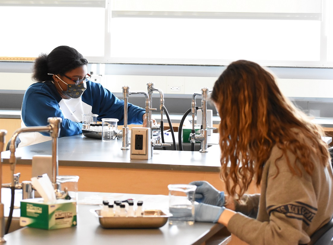 Two students in biology lab