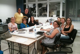 Mary K. Anthony, Ph.D., professor and associate dean of research at Kent State University's College of Nursing (second person seated from left), works with doctoral students at the Federal University of Santa Catarina, Brazi