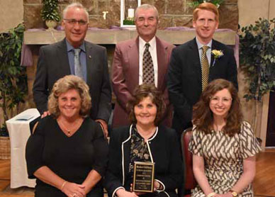 The Bricker family accepted the Community Partner Award, given to Bricker's Cafeteria and Catering.