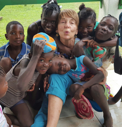 Brook Borgeson Gray with a group of Hatian Children