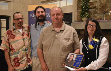 The family of the late Dr. Roxanne Burns accepted the Friends of the Campus Award, given to her posthumously.