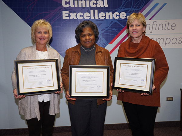 (From left) Tracey Motter, DNP, RN, associate dean for undergraduate programs; Dean Barbara Broome, Ph.D., RN, FAAN; and Wendy Umberger, Ph.D., RN, PMHCNS-BC, associate dean for graduate studies, hold the CCNE accreditation certificates.