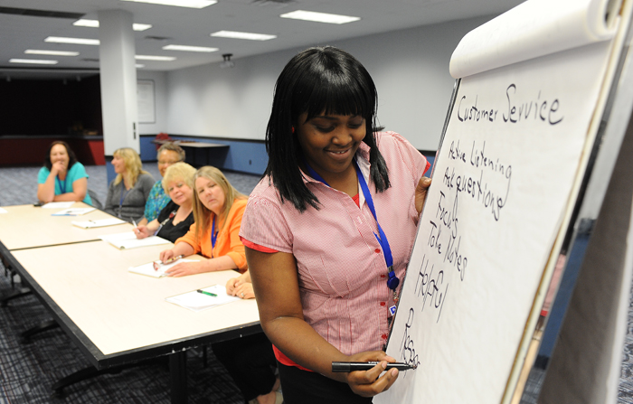A Participant is Engaged in a Group Activity in the Perpetuating Excellence in Customer Service Program