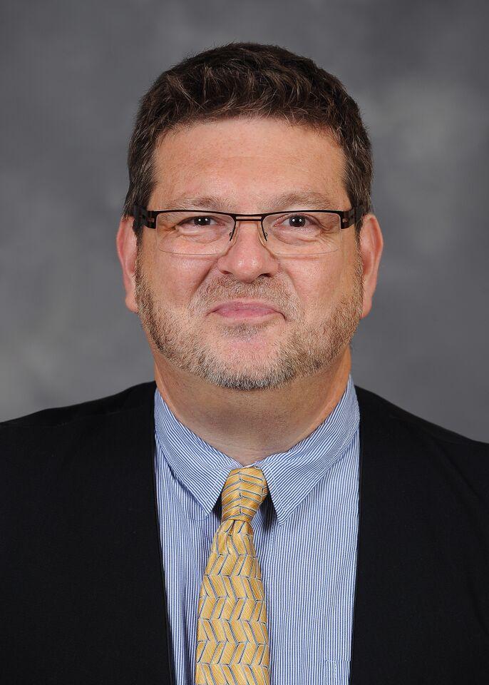Dr. Chris Woolverton