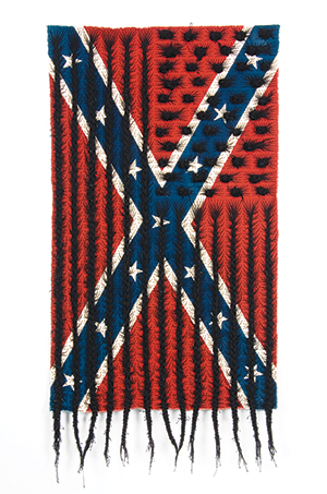 Black Hair Flag (2010) by Sonya Clark. A flag that looks like braids that mimics the American flag and the Confederate flag.