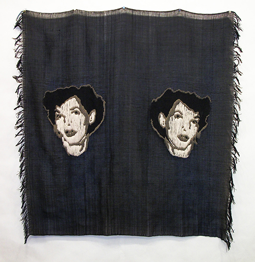 A weaving by student Crystal Cooper - a dark background with two women's faces