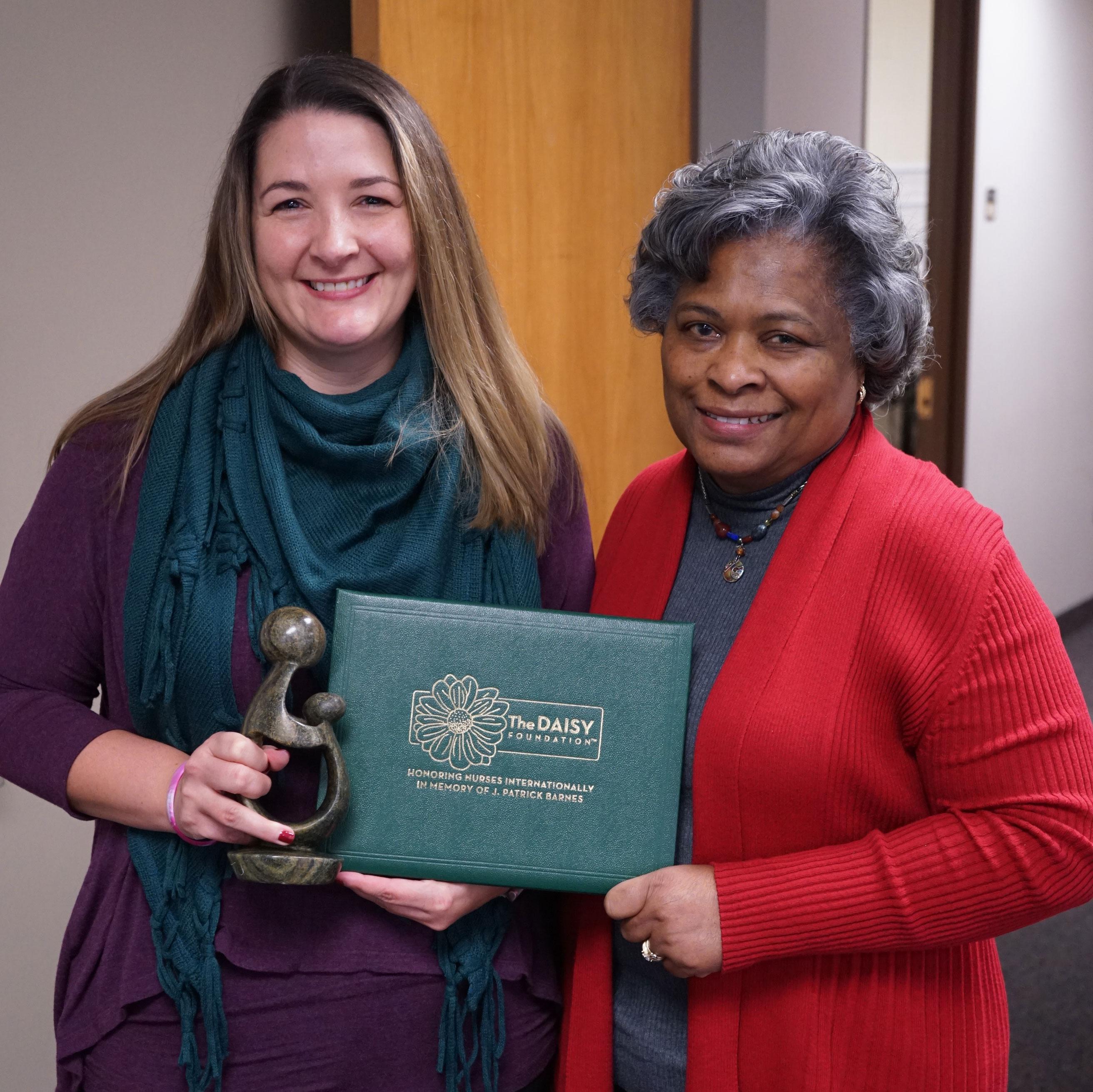 2019 DAISY Award recipient Lisa Daivs (left) and Dean Barbara Broome