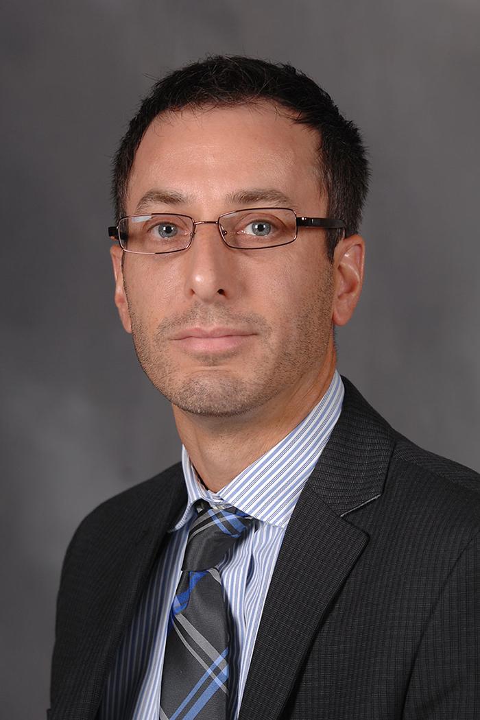 Dr. Deric Kenne