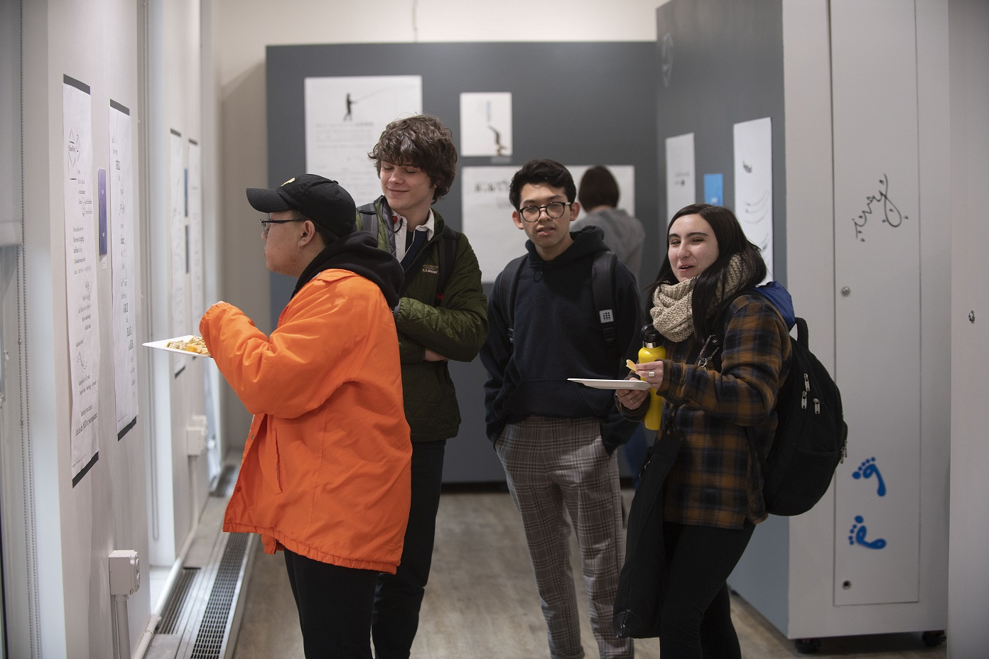 Students admire work at the Concrete Poetry Gallery Opening