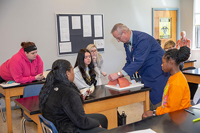 Dr. Dankovich interacting with students in his lab.