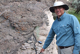 David Hacker, Ph.D., Kent State University at Trumbull associate professor of geology, points to pseudotachylyte layers and veins within the Markagunt gravity slide.