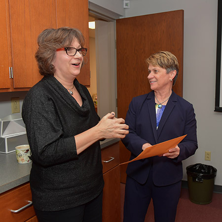 Barbara Davis, administrative secretary in the Department of Anthropology, receives the 2018 President's Award of Distinction from Kent State University President Beverly J. Warren.